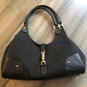 Gucci black and gold mini Jackie purse